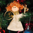 Stock Photo: Angel hanging on fir tree