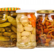 Stock Photo: A set of canned vegetables. cucumbers, mushrooms and carrots.