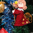 Stock Photo: Red angel hanging on fir tree