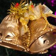Christmas golden bell hanging on fir tree — Stockfoto