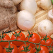 Champignons, tomatoes and onion on a mat - Stock Photo