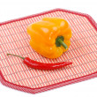 Stock Photo: Yellow and red pepper on a mat