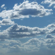 Bright sunny clouds against blue sky — Stock Photo #12119566