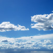 Bright sunny clouds against blue sky — Stock Photo #12119581