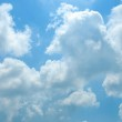 Bright sunny clouds against blue sky — Stock Photo #12119682