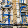 Extensive scaffolding on a aged building in downtown - Stock Photo