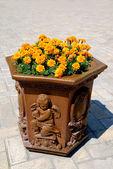 Vase with yellow flowers — Stock Photo