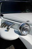 White limousine with decorative element — Stock Photo