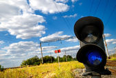 Landscape with a railway traffic light — Foto Stock