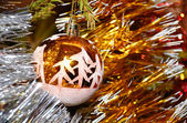 Xmas ball hanging on fir tree — Stock Photo
