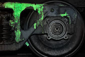 Painted black wheel of a train — Stock Photo