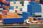 Truck carries container to warehouse near the sea — Stock Photo