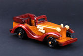 A toy car made of wood — Stock Photo