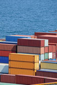 Containers warehouse and sea — Stock Photo