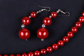 Red beads and necklaces — Stock Photo