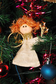 Angel hanging on fir tree — Stock Photo