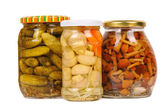 A set of canned vegetables. cucumbers, mushrooms and carrots. — Stock Photo