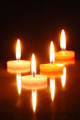 Burning candles isolated on black — Stock Photo