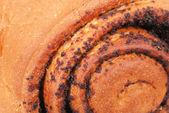 Fresh bun with poppy seed — Stock Photo