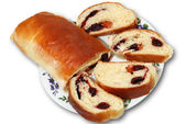 The roll with jam on a plate — Stock Photo