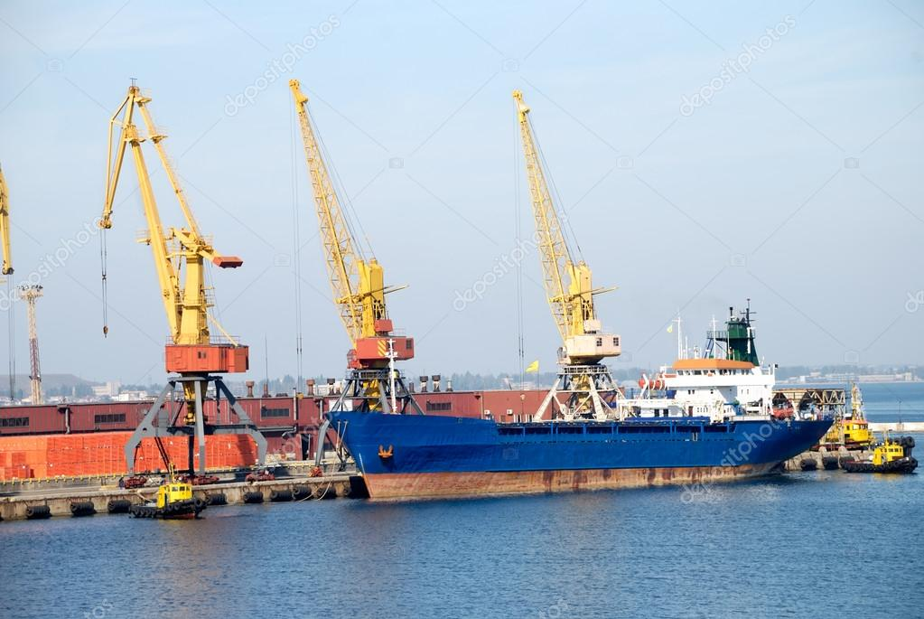 View on the port with loading cargo ship — Stock Photo #12116291