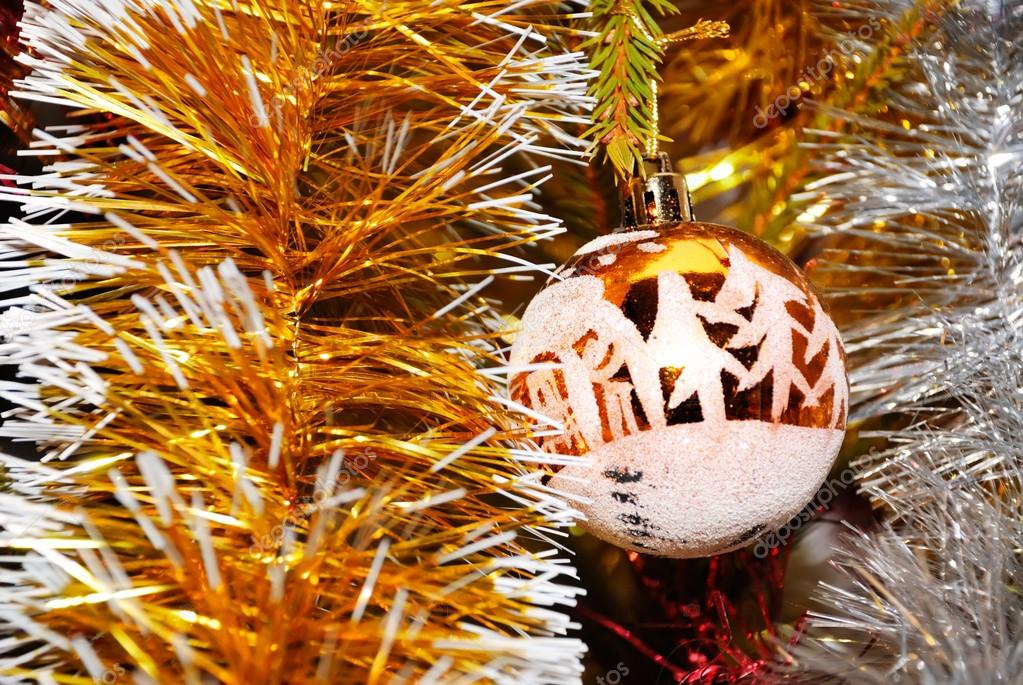 Yellow xmas ball hanging on pine twig with other decoration — Stock Photo #12117149