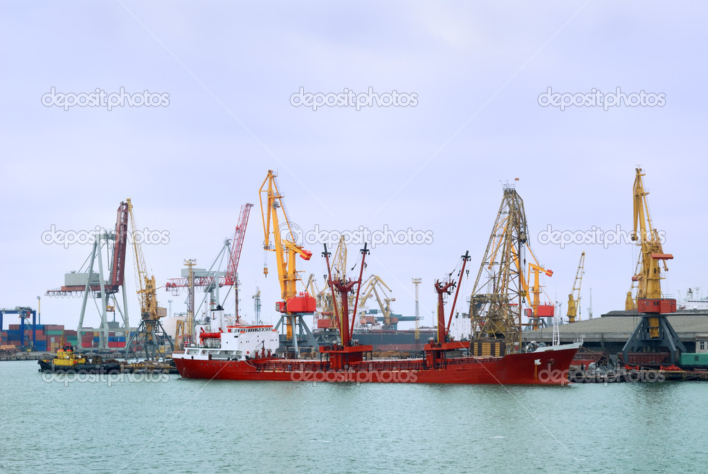 View on trading port with an unloading vessel  Stock Photo #12119390