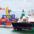 The trading seaport with cranes, cargoes and ship - Stock Photo