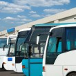 Tourist buses on a parking - Stock Photo