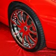 Chromeplated wheel on red — стоковое фото #12120422