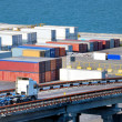 Port warehouse with cargoes and containers - Foto Stock