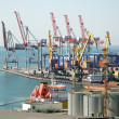 Stockfoto: Port warehouse with cargoes and containers