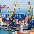 The trading seaport with cranes, cargoes and ship — Stock Photo #12120510