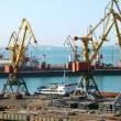 The trading seaport with cranes, cargoes and ship — Stock Photo #12120526