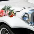 Stock Photo: White wedding limousine with flowers