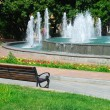 Stock Photo: City park with a fountain