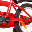 New red children's bicycle on white - Stock Photo