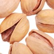 Pistachios nuts isolated on white - Stock Photo