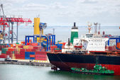 The trading seaport with cranes, cargoes and ship — Stock Photo