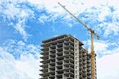 Building crane and not complete skyscraper — Stock Photo