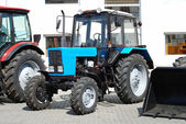 New tractor on a showcase — Stock Photo