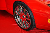 Chromeplated wheel on a red — Stock Photo