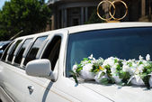 White wedding car with flowers — Stock Photo
