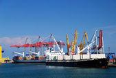 Cargo ship in port — Stock Photo