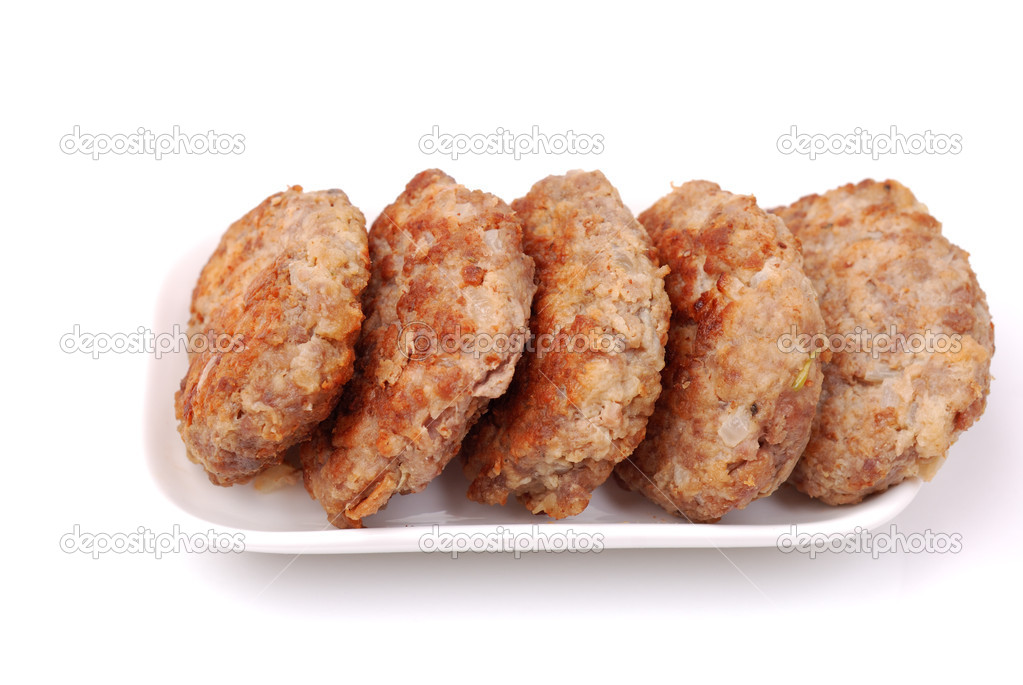Meat formed into a ball on a white plate  Stock Photo #12120296