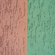 Red and green striated stucco wall texture — Stock Photo