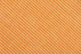 Orange striped fabric background — Stock Photo