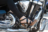 Women foot on a motorcycle engine — Stock Photo