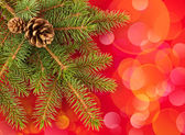 Christmas tree with red bokeh background — Stock Photo