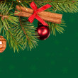 Stock Photo: Christmas tree decoration on green